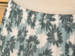 Jupe plissée fleurie, verte